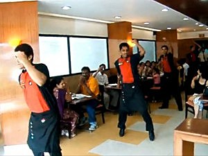 Dancing waiters at Pizza Hut India