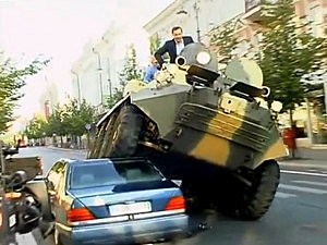 Tank Crushes Illegally Parked Car