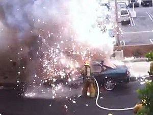Car explodes in firefighter's face