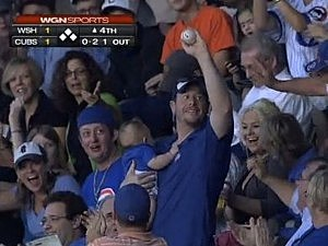 Dad catches foul ball with baby in other hand