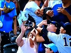 Woman takes foul ball off face