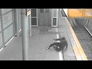 Boy Runs In Front of A Train and Just Makes It Out Alive