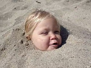 Little girl wants more sand