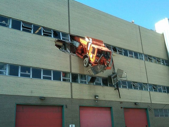 Truck dangles from parking garage
