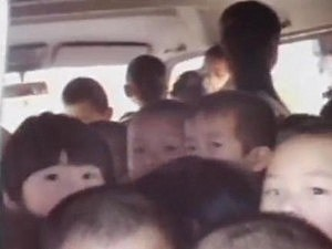 66 kids stuffed into minivan in china
