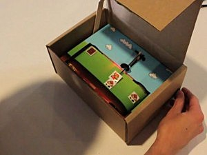 Super Mario Bros in a cardboard box