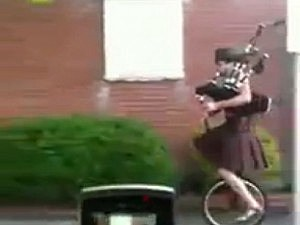 Unicyclist in kilt plays Star Wars theme on Bagpipes