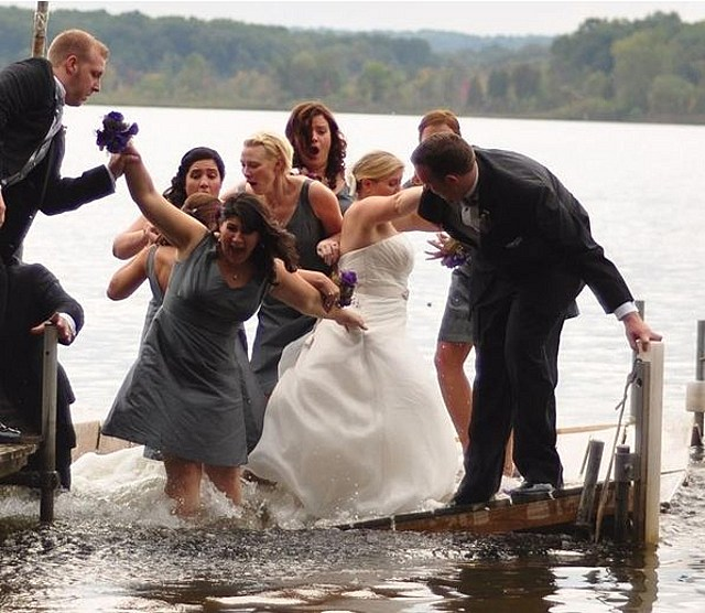 Bridal party falls into lake