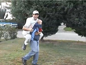baby carries dad