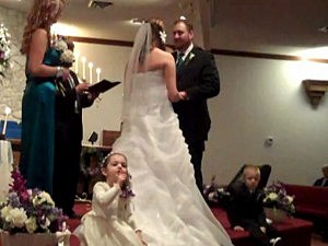 flower girl shushes pastor