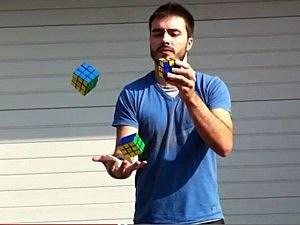 Man Juggles Rubik's Cubes