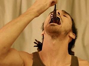 louis eating scorpion