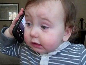 Baby Makes a Pretend Phone Call
