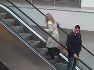 Blonde Goes the Wrong Way on an Escalator