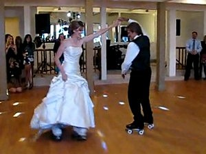 Father-Daughter Duo Dance on Roller Skates