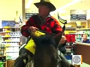 Cowboys Ride Horses in Safeway