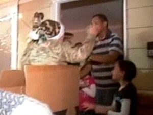 Returning Soldier Jumps Out of Christmas Present
