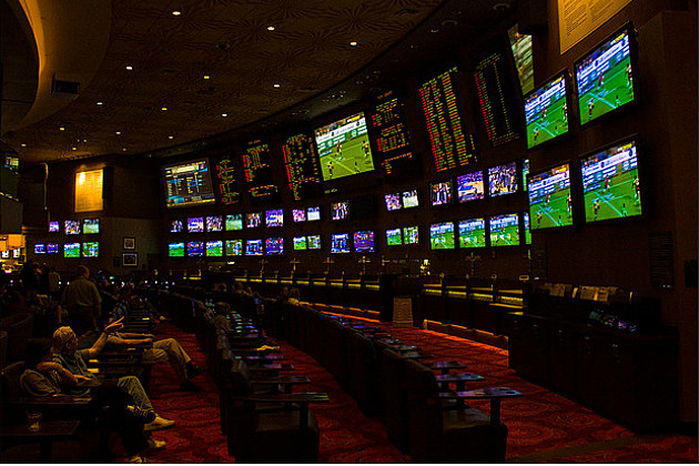 wall of monitors showing the game at MGM Sports Book