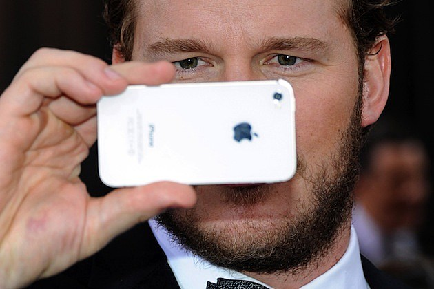 84th Annual Academy Awards - Arrivals cell phone