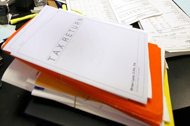 Tax Filer Feels Crunch Of April 15 Tax-Filing Deadline tax return paperwork