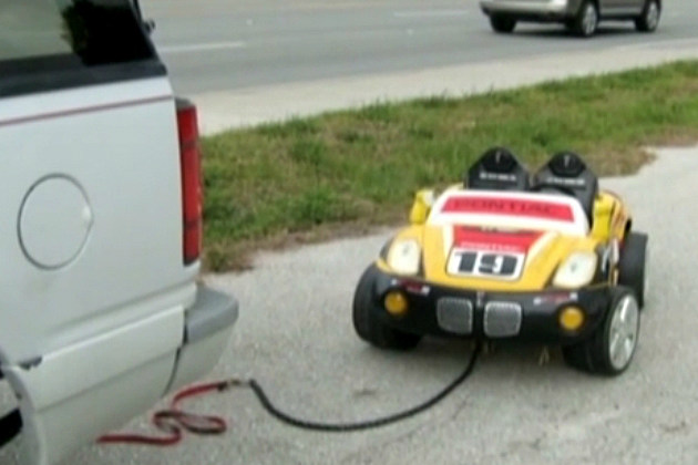 Drunken Grandparents Tow Child in Toy Car
