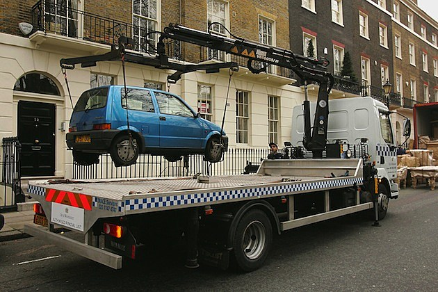 Authorised Removal Unit Removes Illegally Parked Car tow truck