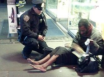 Police officer giving boots to homeless man