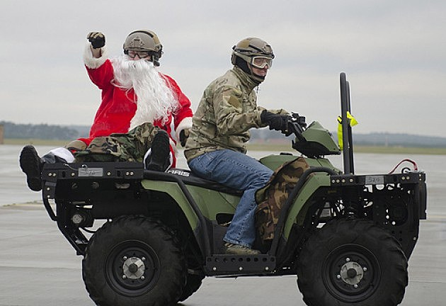 Santa on the back of a ATV