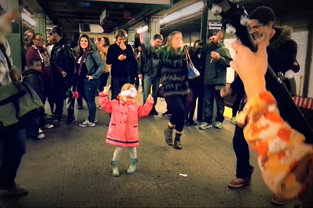 little girl pink jacket subway dancing